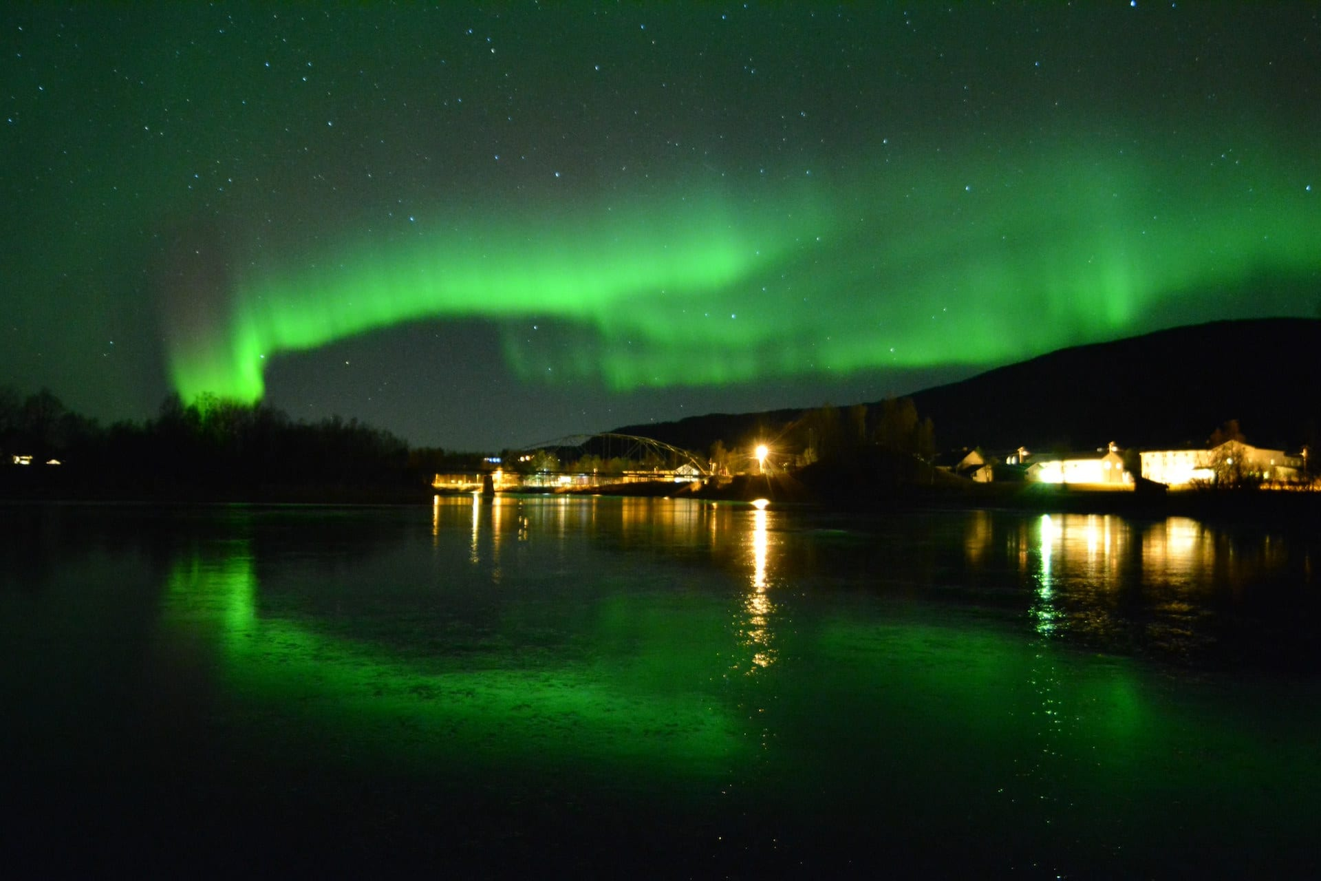 Green Northern Lights show over Rundhaug Gjestegård in Norway