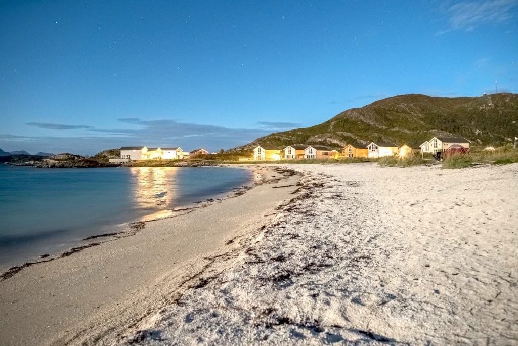 Twilight view of the white beach next to Sommarøy Arctic Hotel in summer near Tromsø, Arctic Norway