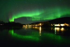 Green Northern Lights show over Rundhaug Gjestegård in Norway