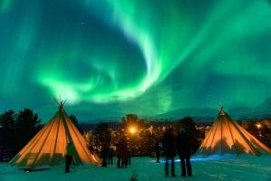 bright northern lights at aurora camp in skibotn, arctic norway