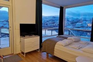 bedroom view in autumn from fishermens rorbuer cabin svolvær lofoten norway