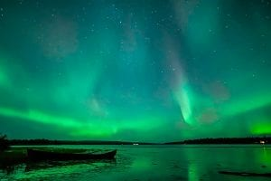 northern lights over lake lapland finland
