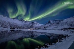 northern lights over fjords in lofoten norway