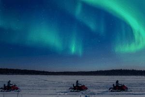 northern lights snowobile skidoo safari lapland finland