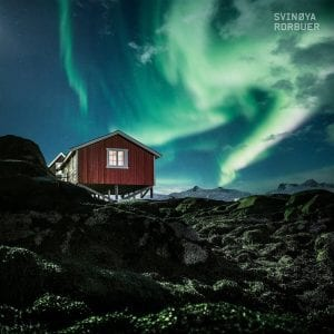 northern lights above rorbuer fishermens cabin autumn in svolvaer lofoten islands norway