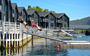 summer in Senja Norway people jumping into the water
