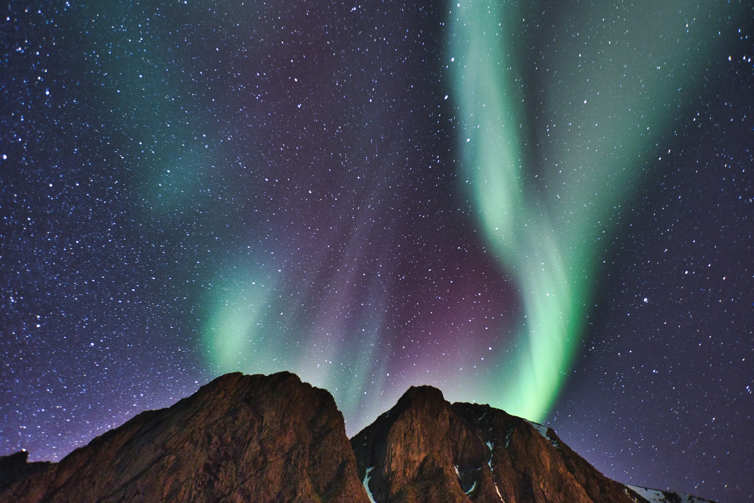 northern lights aurora over fjords mountains